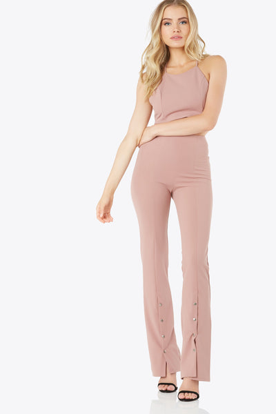 High-waisted bell bottom pants. Metal snap closures on the lower half of pant leg.