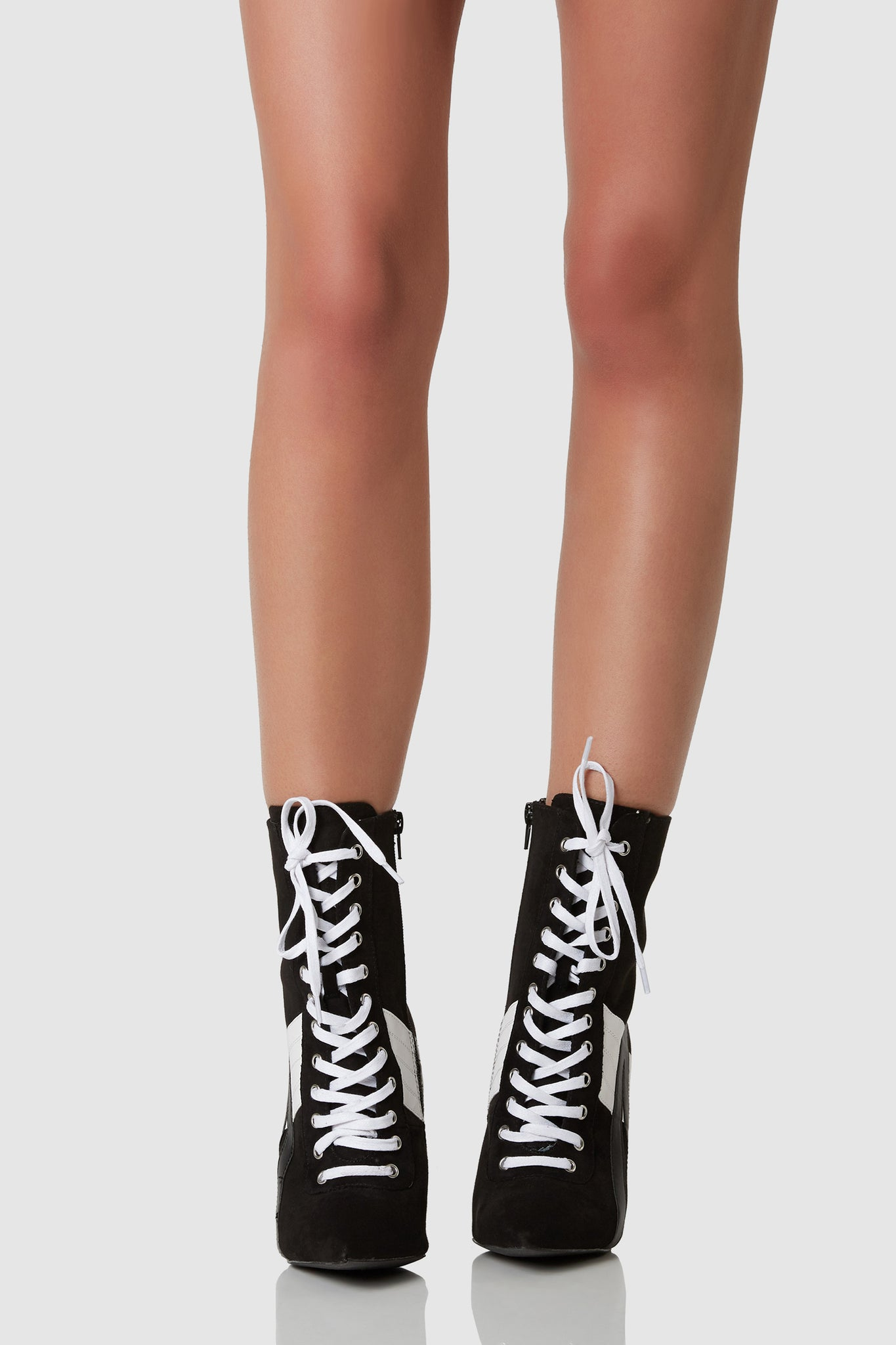 Stylish above the ankle lace up booties with sexy stiletto heels. Pointed toe finish with contrast stripe patterns and lace up finish for an athletic vibe.