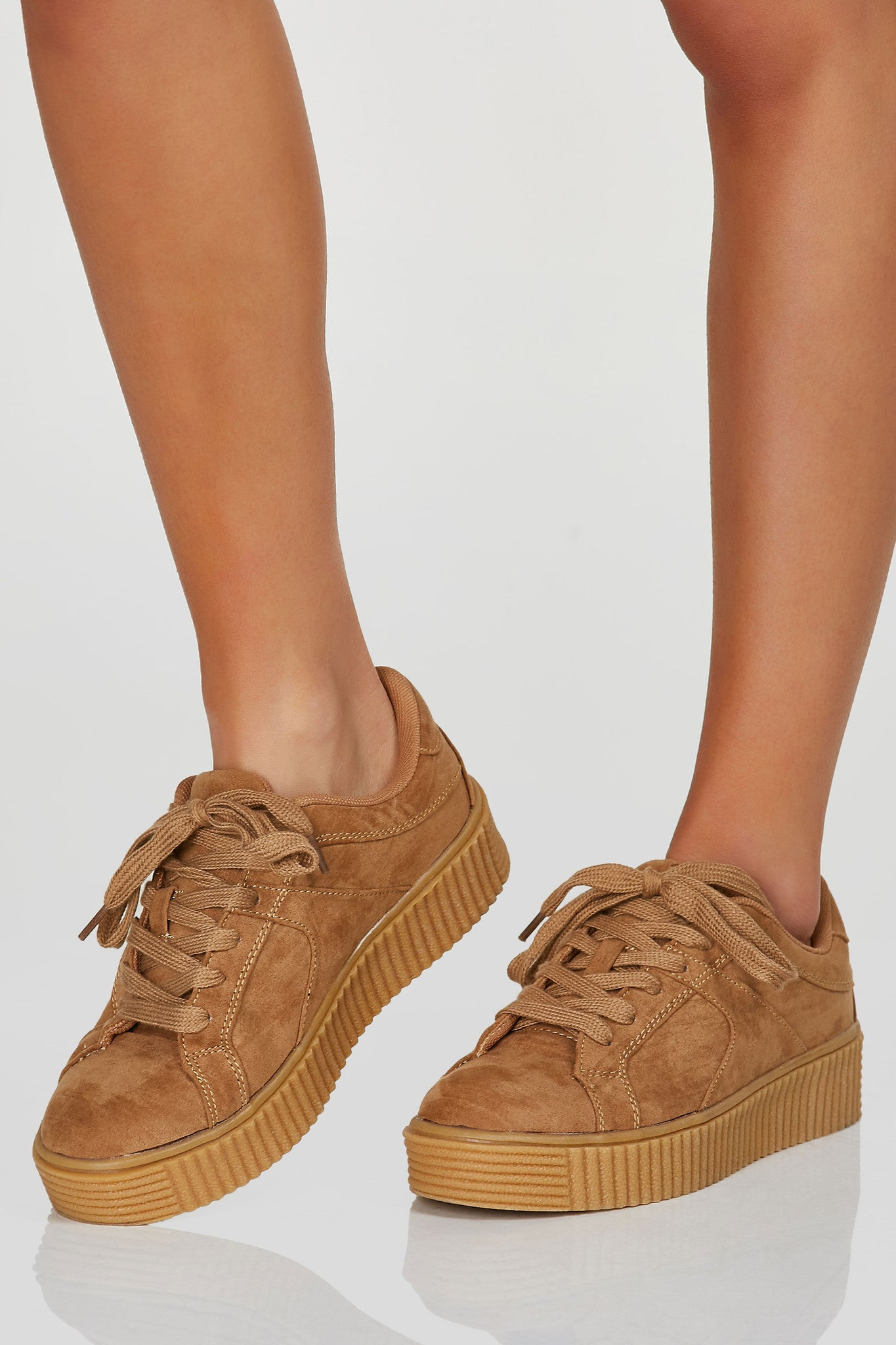 A trendy pair of classic creeper style sneakers with soft suede finish. Lace up closure with adjustable fit with comfy platform soles.