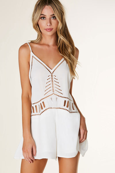 Chic sleeveless romper with adjustable spaghetti straps and classic V-neckline. Relaxed fit with laser cut out design all around.