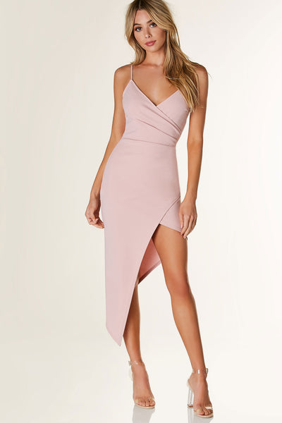 Sexy sleeveless wrap dress with classic V-neckline and spaghetti shoulder straps. Ruched on one side with asymmetrical hem.