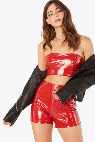 Sexy faux leather tube top with back zip closure. Smooth lining and straight hem finish.