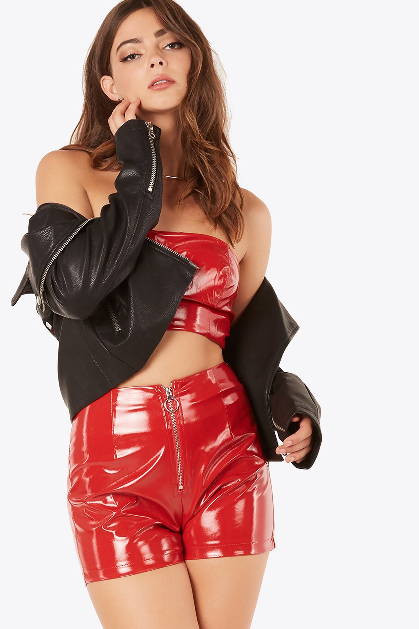 High rise faux leather shorts with sexy body hugging fit. Front zip closure with trendy hoop detailing.