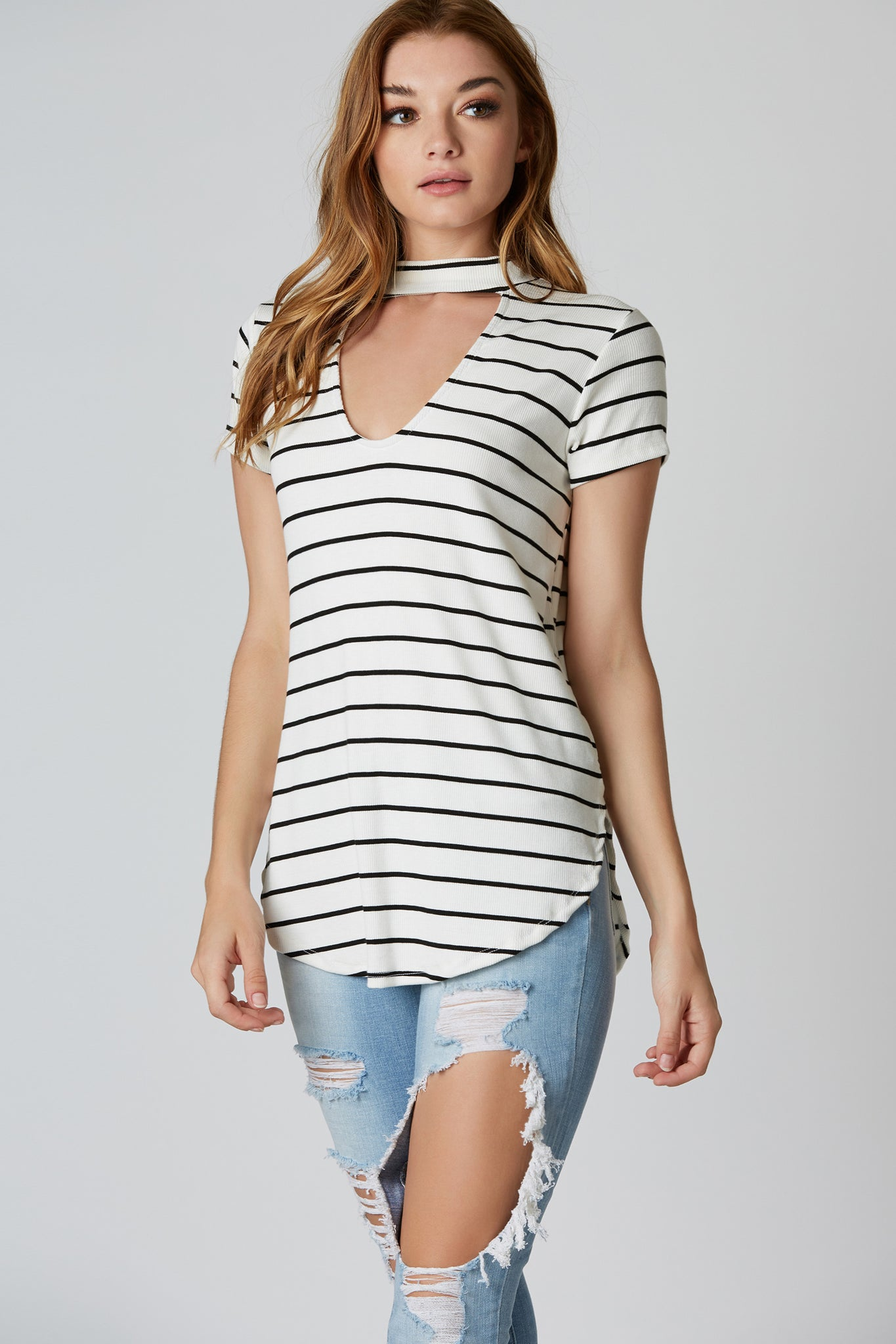 Casual ribbed short sleeve top with stripe patterns throughout. Cut out choker neckline with oversized fit and rounded hem finish.