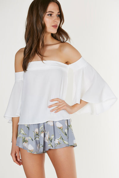 Flowy off shoulder blouse with flirty bell sleeves. A-line hem with back zip closure.