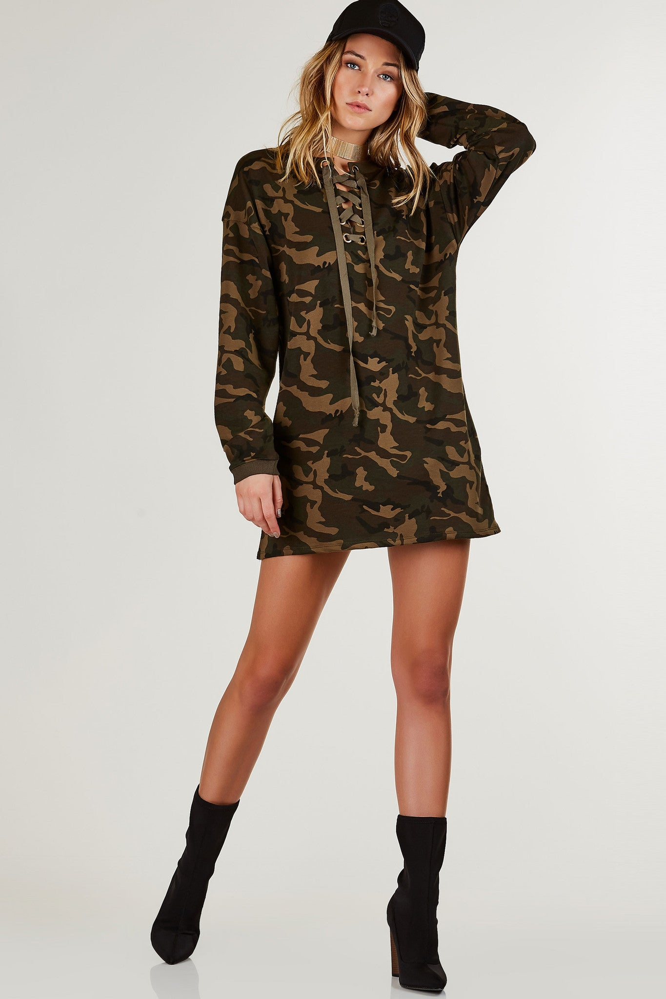 Long sleeve printed tunic dress with ribbed neckline. Eyelet detailing with lace up design and oversized fit.