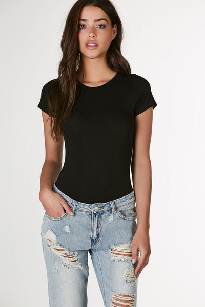 Basic crew neck short sleeve T-shirt style bodysuit. Soft stretchy material with cheeky cut and snap button closure.