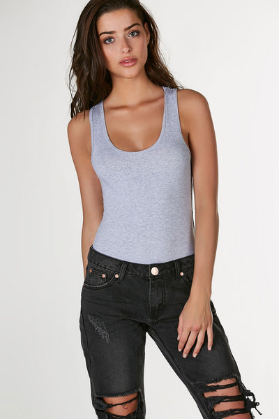 Basic sleeveless bodysuit with racer back and slim fit. Comfortable stretchy material with cheeky cut and snap button closure at bottom.