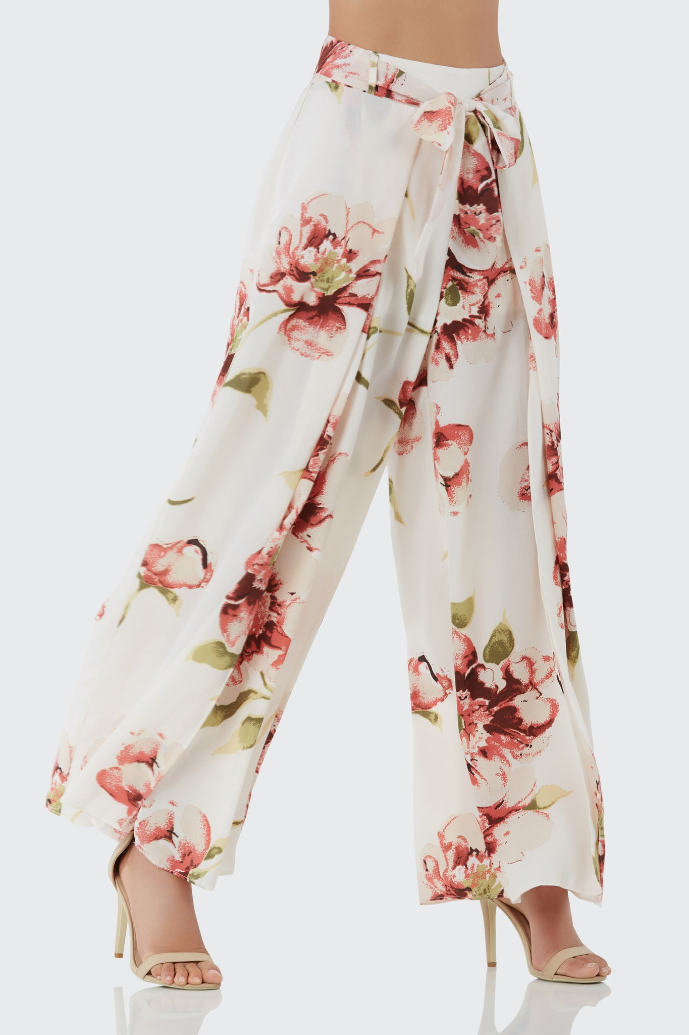 High rise printed pants with floral patterns throughout. Waist tie detailing with bold slits on each side.