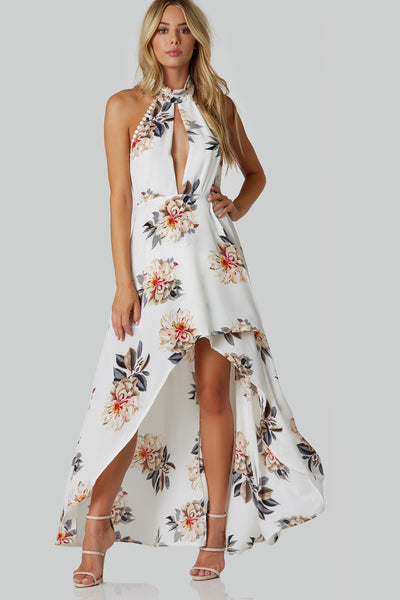 Floral printed halter neck dress with center slit and crochet trim detailing. Smooth lining with open back and hi-low hem finish.