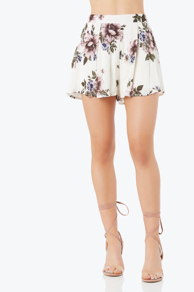 Flowy high rise shorts with A-line hem. Floral print throughout with smooth lining.