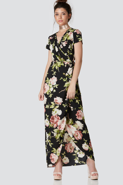 Flowy short sleeve wrap dress with deep V-neckline and tie at waist for closure. Floral print throughout with curved hem finish.