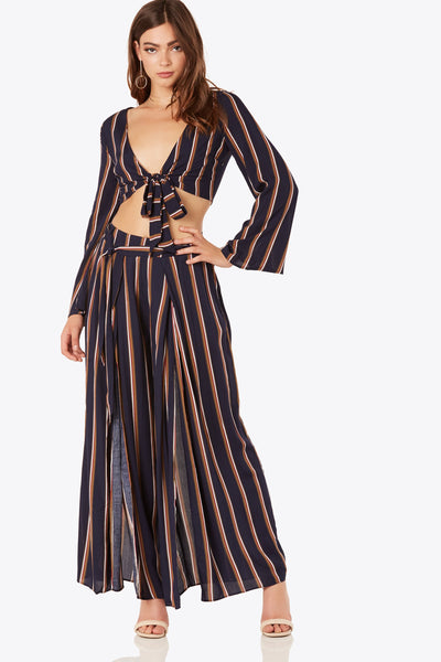 Flowy printed pants with stripe pattern throughout. Front slit design with tie detailing at waist.