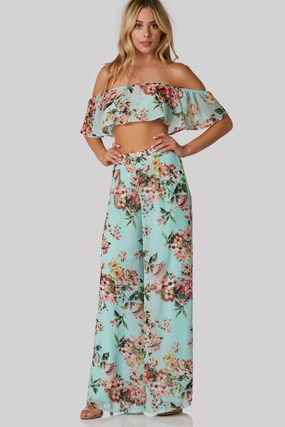 Flattering off shoulder chiffon top with flowy cropped hem and comfortable elastic band at top.