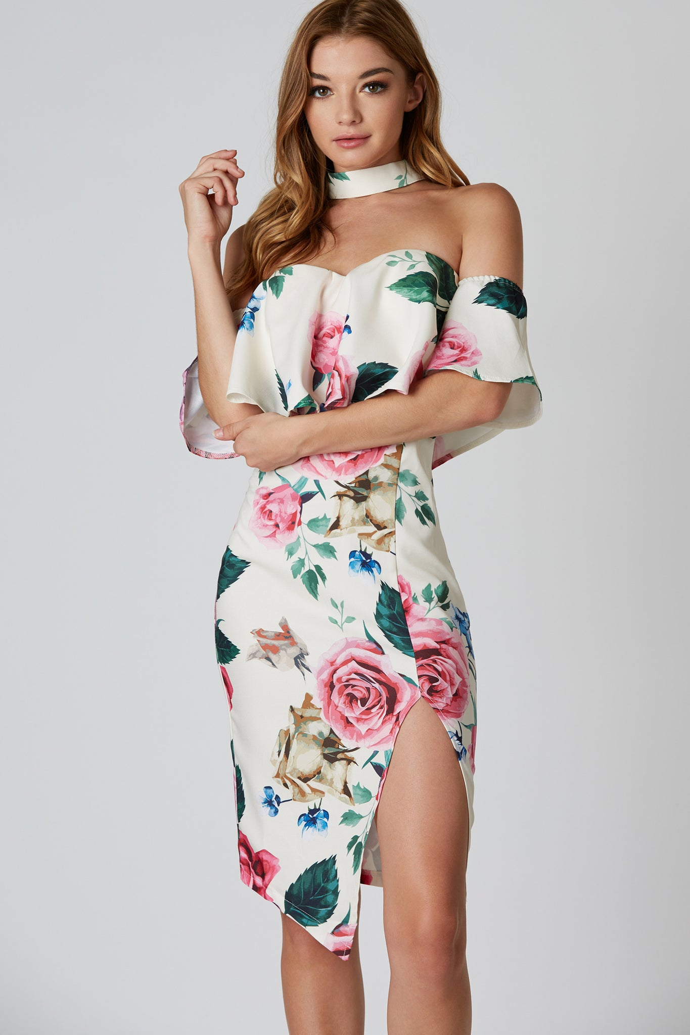 Colorful printed midi dress with floral patterns throughout and flattering choker neckline. Asymmetrical hem with slit in front and back zip closure.