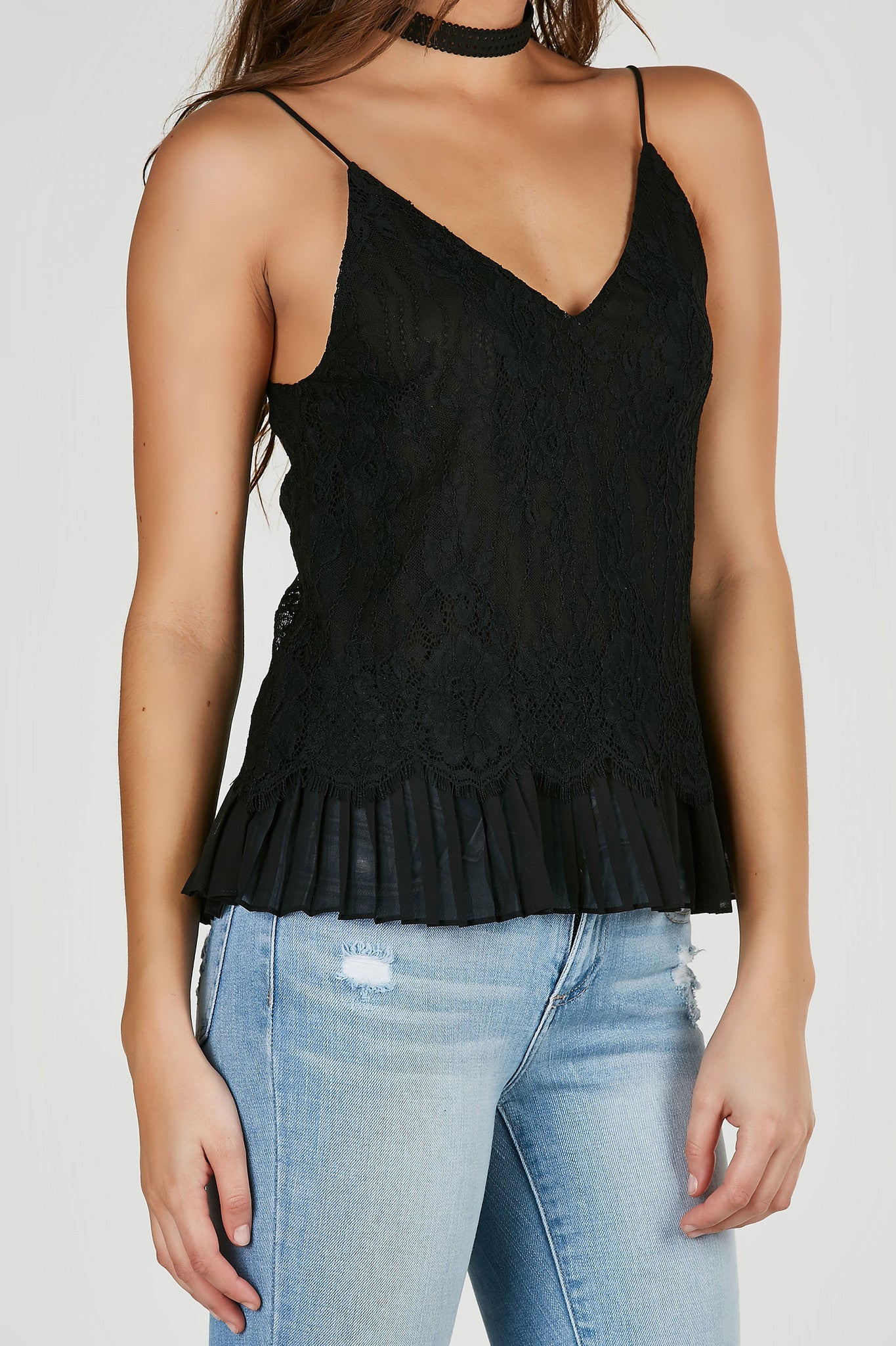 V-neck spaghetti strap cami with delicate lace overlay. Pleated trimmed lining with relaxed fit.