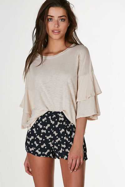 Relaxed fit round neck top with ruffled 3/4 length sleeves. Lightweight material with straight hem all around.