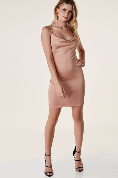 Sexy sleeveless mini dress with draped neckline and bodycon fit. Open back with strappy detailing.