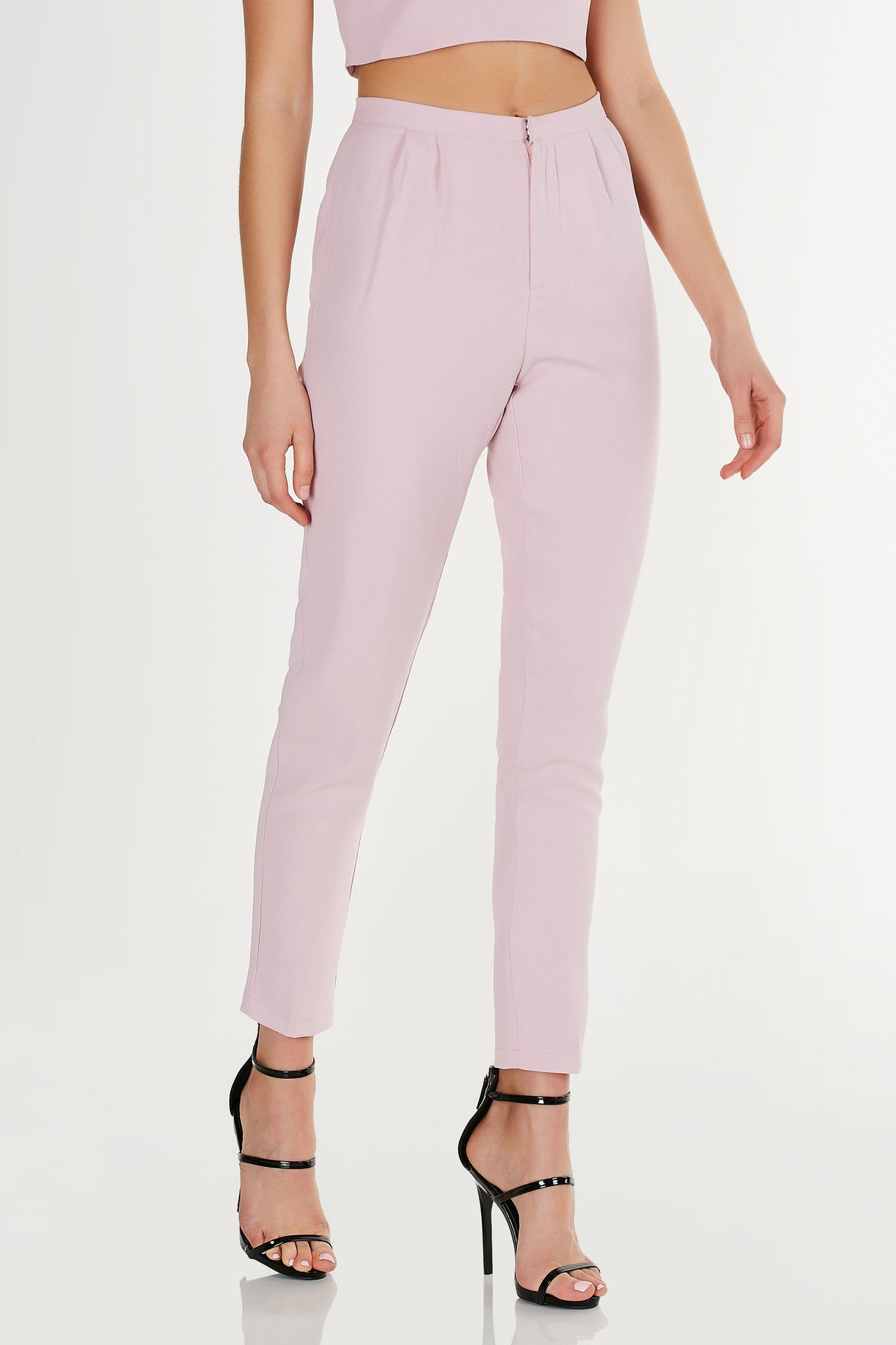 Super chic pair of slacks with high waistline and tapered hem. Comes in a set with matching top sold separately.