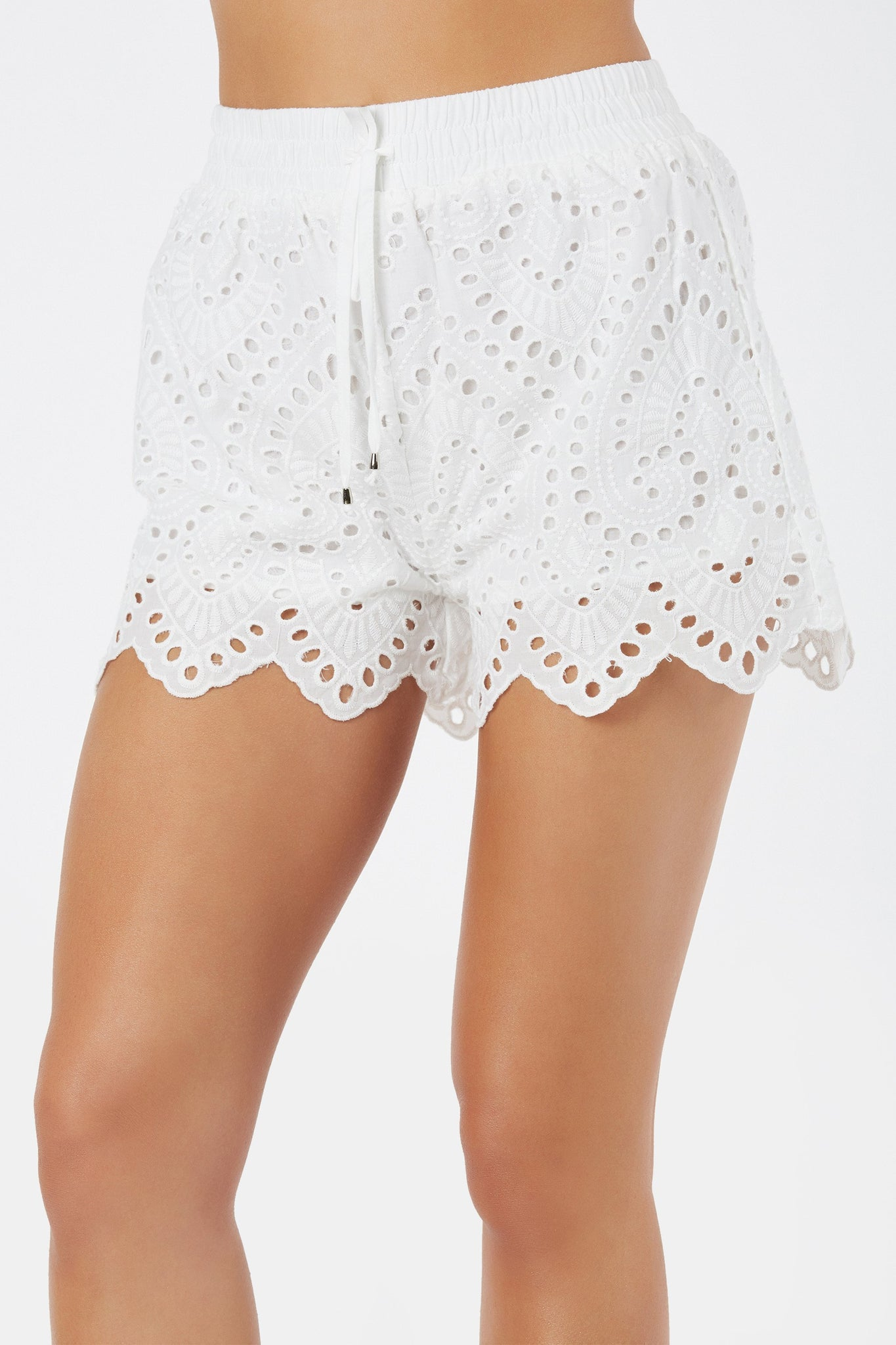 Fully lined high rise shorts with floral embroidery throughout. Elasticized waist with faux drawstring detailing and A-line hem finish.