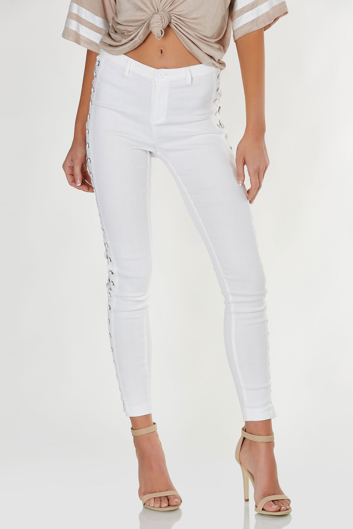 Stretchy mid rise pants with slim fit and lace up design on each side.