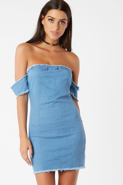 Chambray off shoulder mini dress. Stretchy fit with frayed hem finish all around.