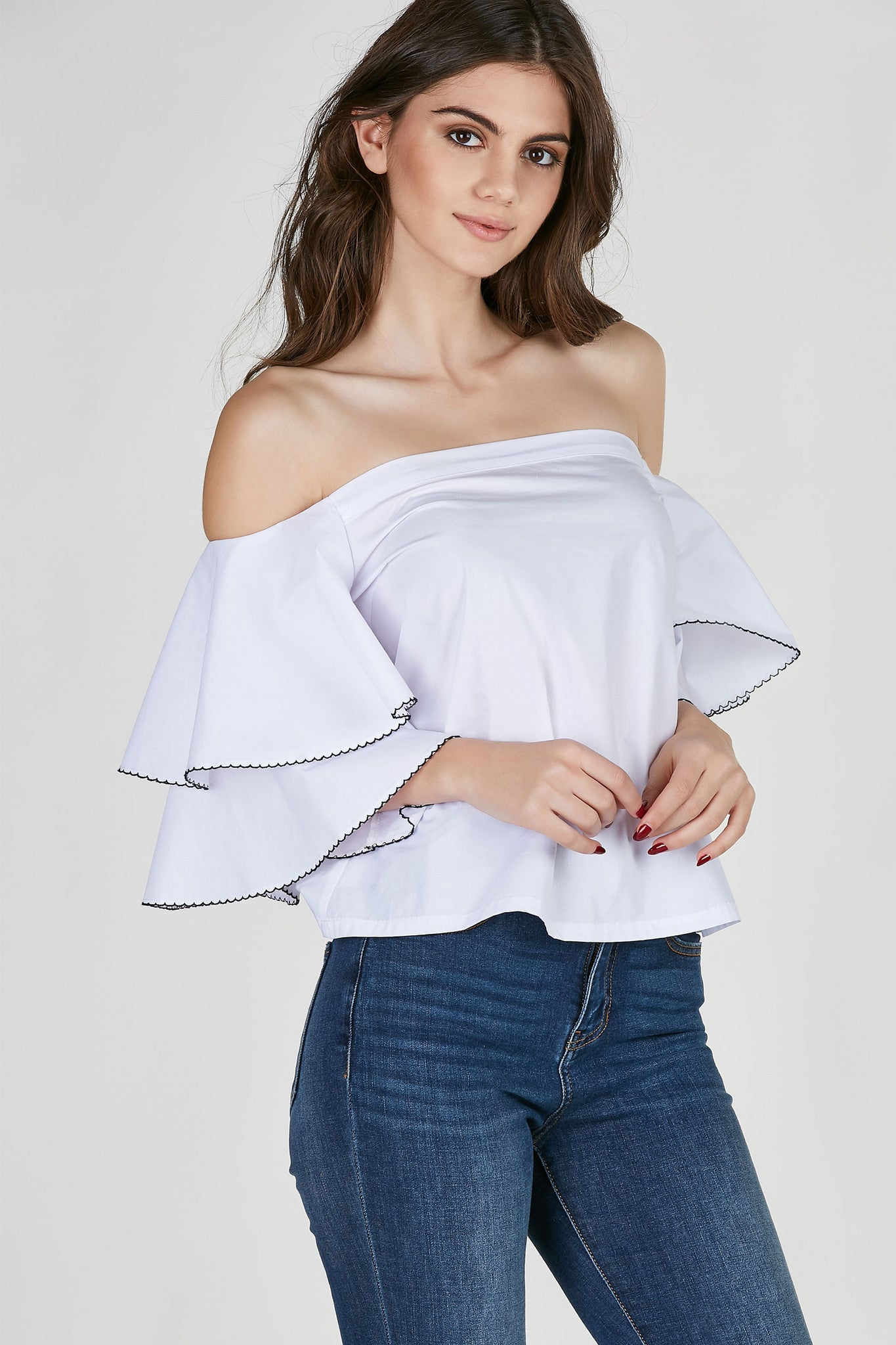 Lightweight off shoulder top with tiered flared sleeves. Contrast trim detailing with boxy fit.