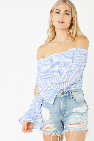 Lightweight off shoulder blouse with chic stripe pattern throughout. Faux button detailing in front with relaxed fit.