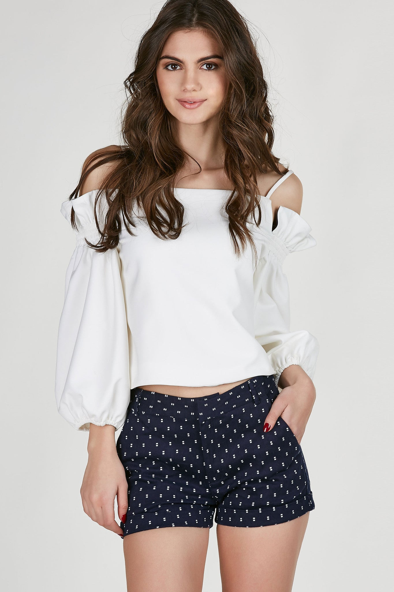 Structured cold shoulder top with spaghetti shoulder straps. Ruffle detailing by shoulders with boxy fit.