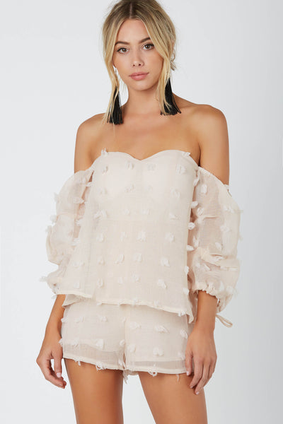 Chic off shoulder romper, fully lined with tiered design. Contrast fringe detailing with structured sleeves and back zip closure.