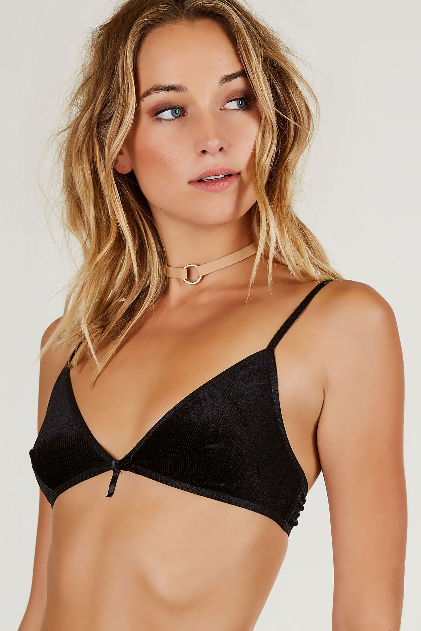 Basic V-neck bralette with velvet finish. Ribbed throughout with hook and eye clasps for fit and closure with adjustable shoulder straps.