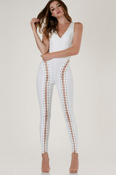 Sexy sleeveless jumpsuit with body hugging fit. Lace up design from top to bottom with back zip closure and bold cut out panel down each leg.