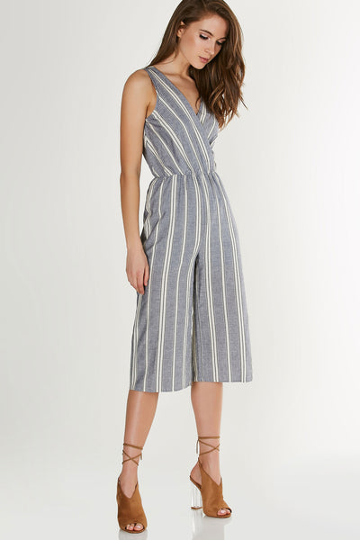 Chic sleeveless jumpsuit with stripe patterns throughout. Overlap neckline with elasticised waist and straight leg fit.