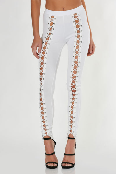 Slim fit, mid rise leggings with trendy cut out down each leg and lace up design.