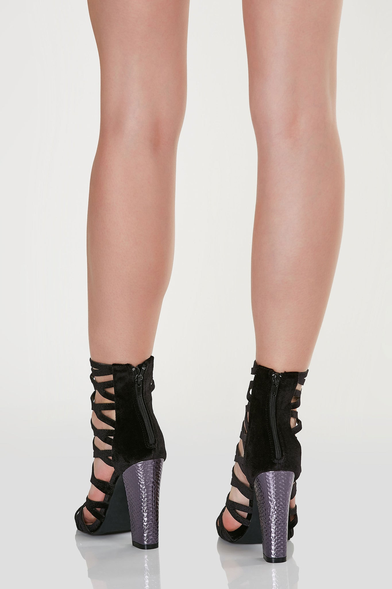 Sexy above the ankle cut out heels with caged design and open toe finish. Contrast block heels with textured finish.