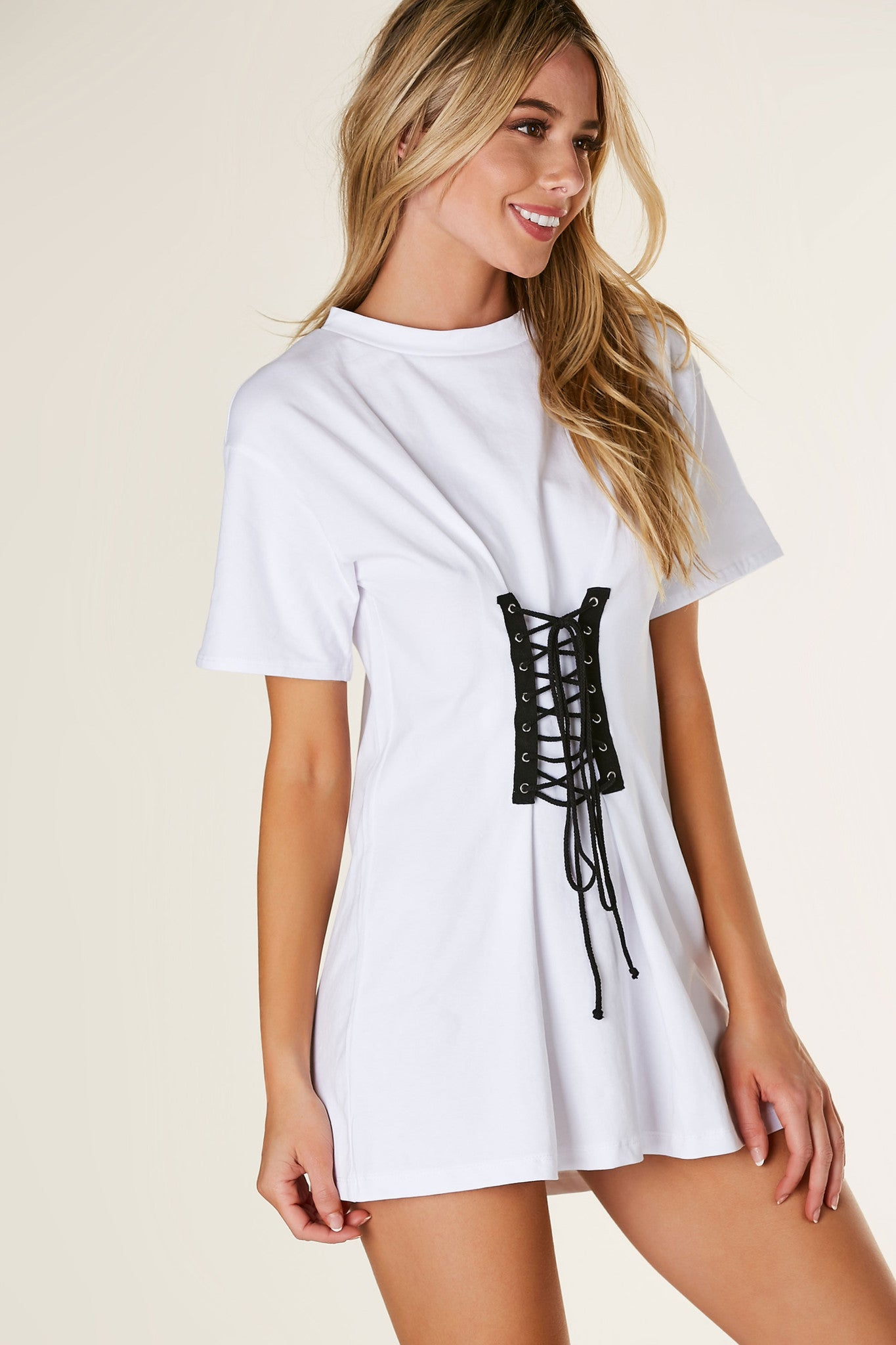 Basic crew neck T-shirt dress with oversized fit and trendy lace up design at center.