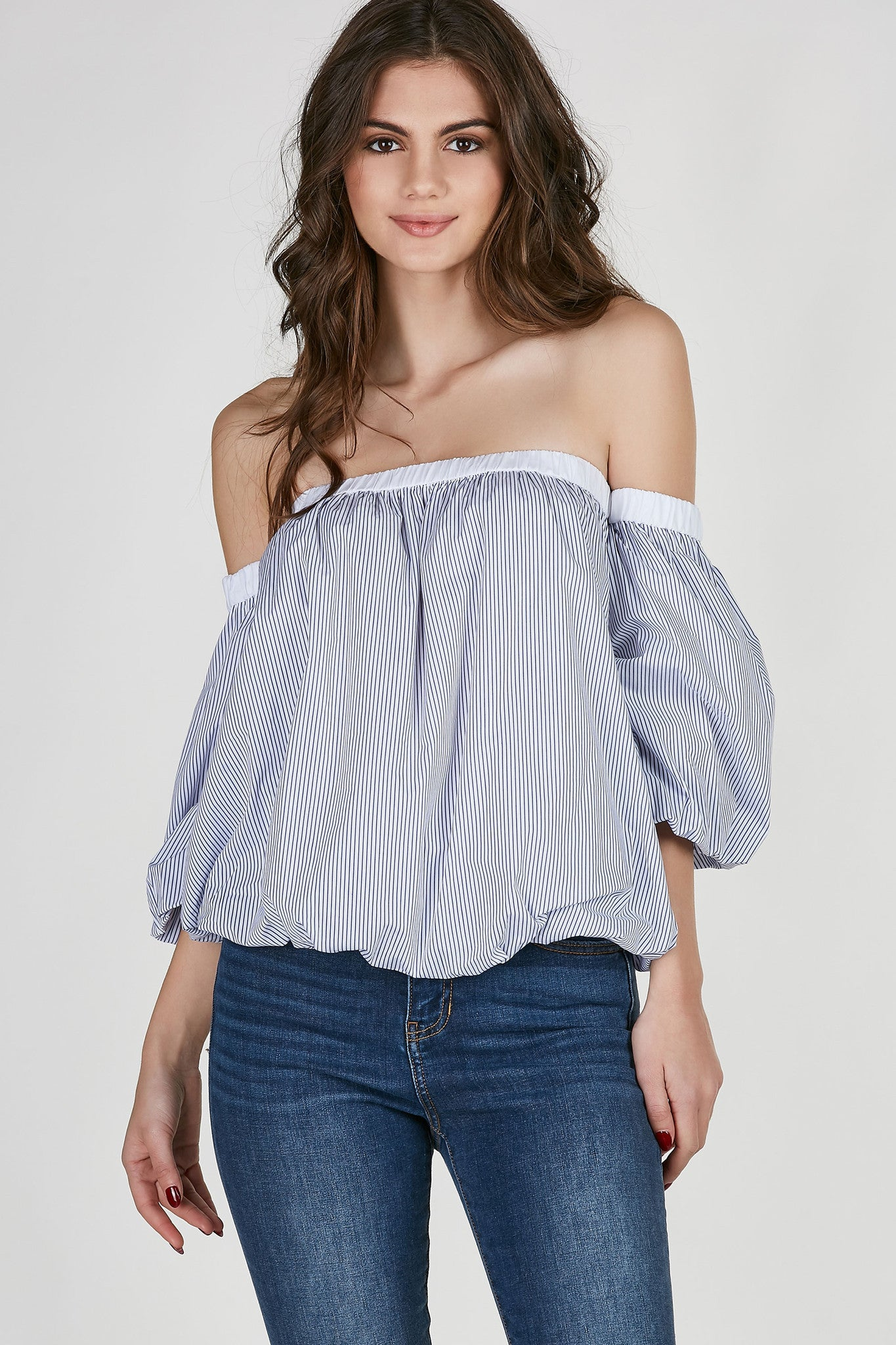 Striped off shoulder blouse with full lining. Contrast neckline with dimensional fit.