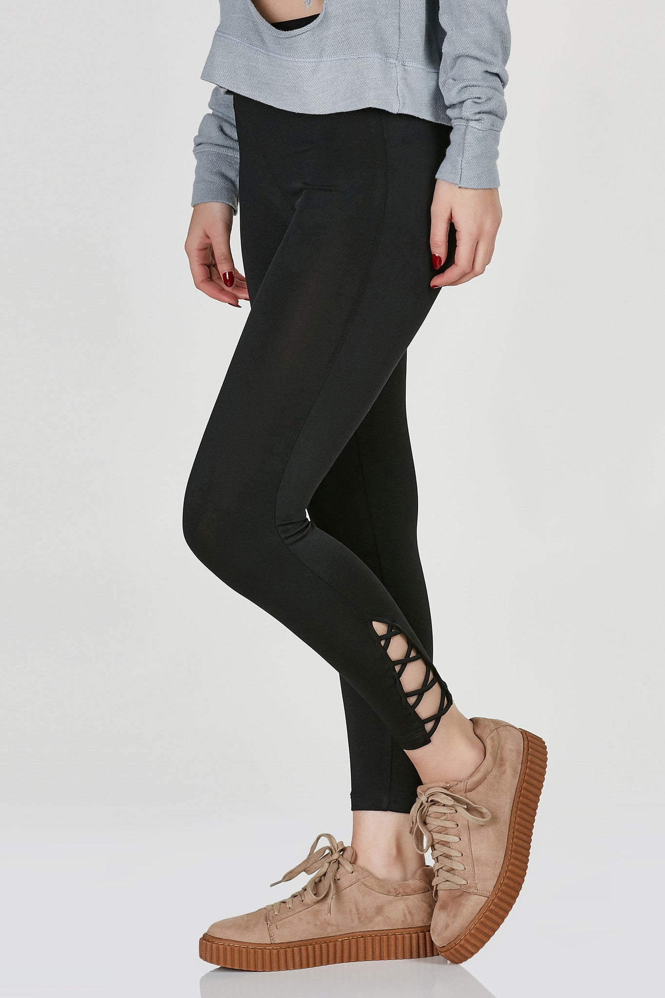 High rise cropped leggings with trendy lace up design at hem. Stretchy material with flattering slim fit.