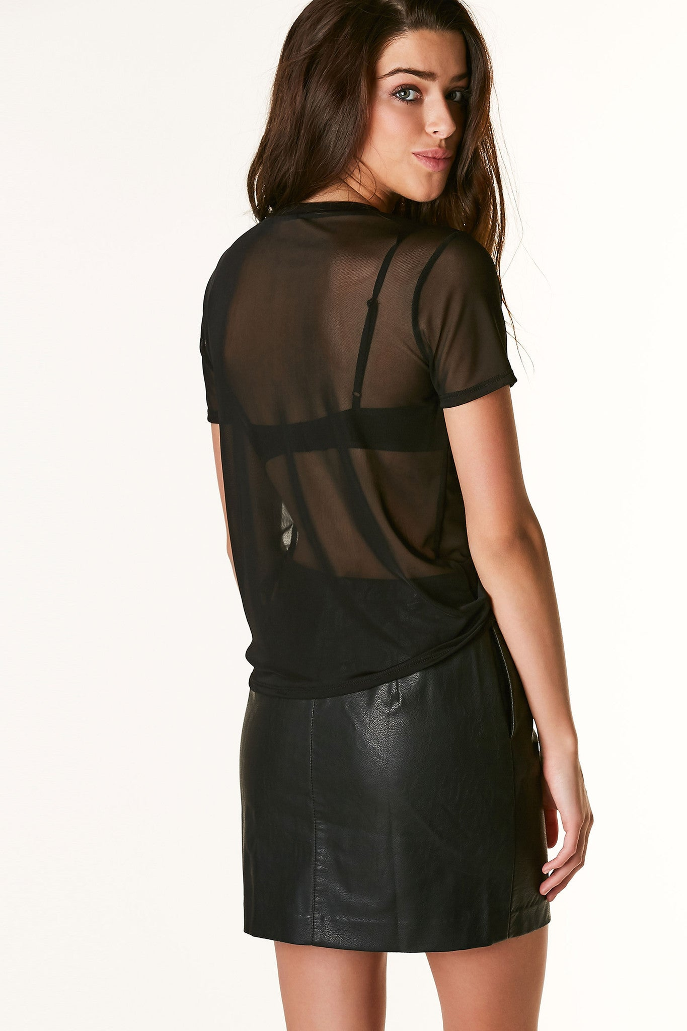 Sheer mesh T-shirt with crew neckline and straight hem finish. Contrast textured graphic in front with relaxed fit.