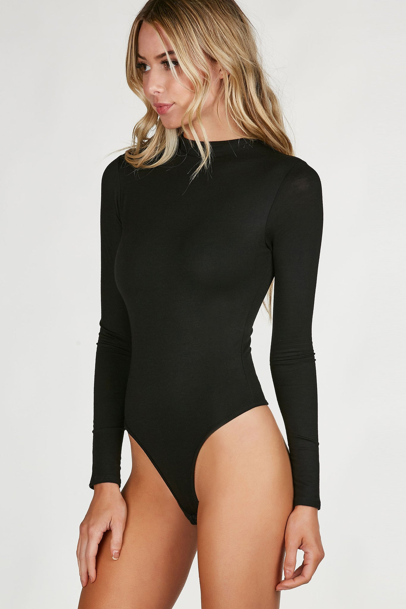 High neck long sleeve bodysuit with slim fit all around. Comfortably stretchy material with cheeky cut and snap button closure.
