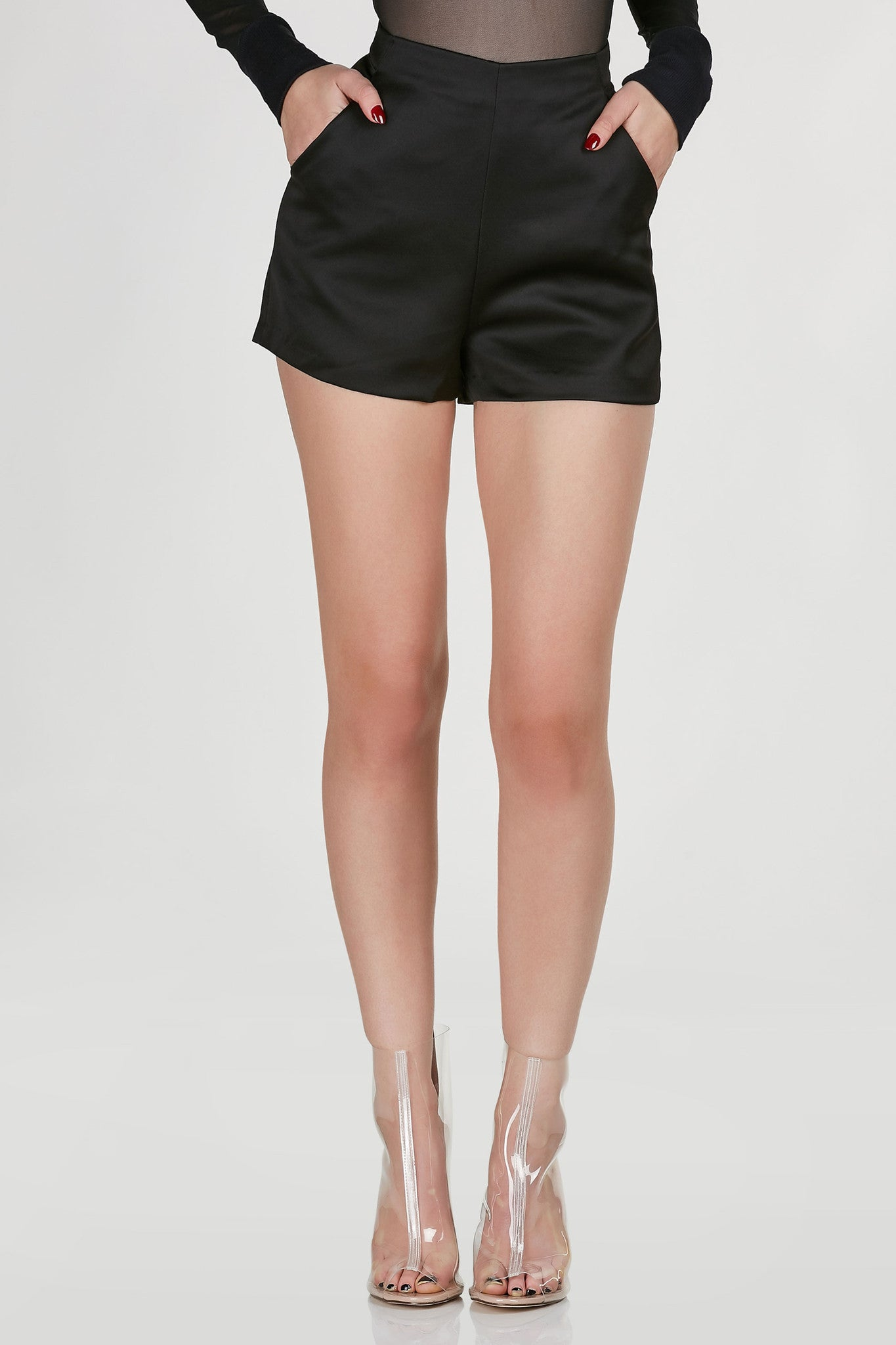 High rise shorts with chic smooth finish. Fully lined with functional pockets and exposed side zip closure.