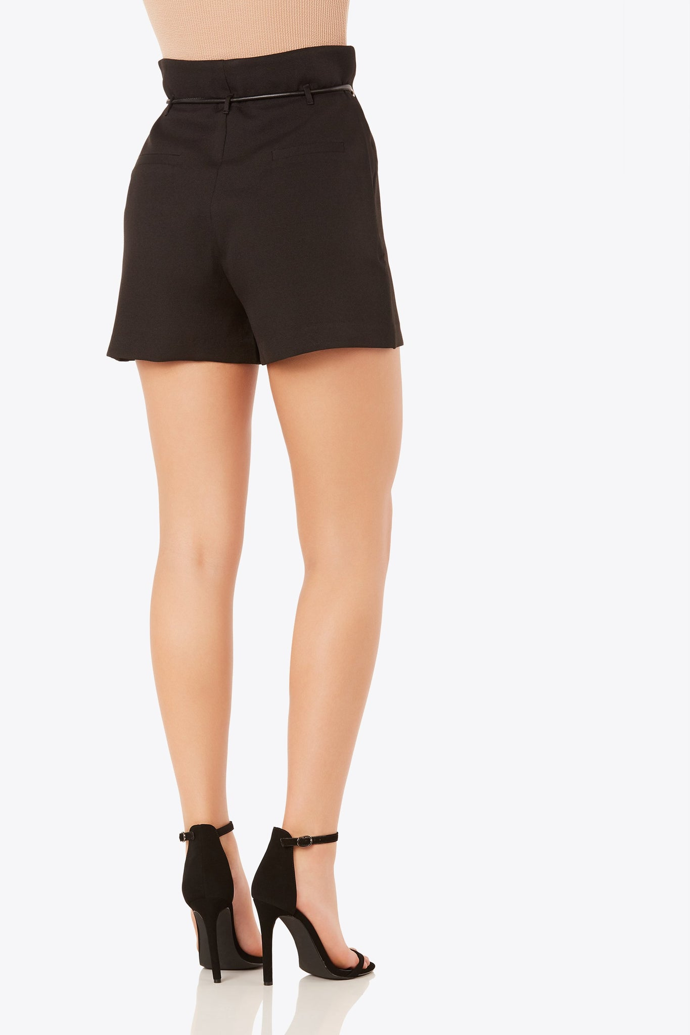 High rise shorts with front zip and button closure. Faux back pockets and eyelet detailing in front. Contrast cord tie at waist with straight hem finish.