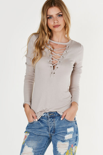 Ribbed long sleeve top with curved neckline and plunging cut out. Lace up design with rounded longline hem.