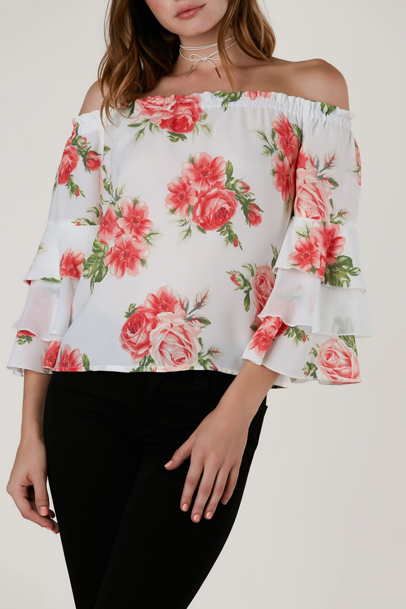 Lightweight off shoulder top with elasticized neckline for comfortable fit. Tiered bell sleeves with floral print throughout.