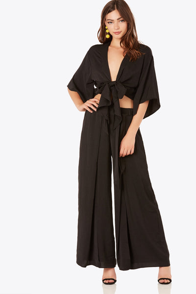 Chic high rise pants with flowy wide leg fit. Front slit design with waist tie detailing.