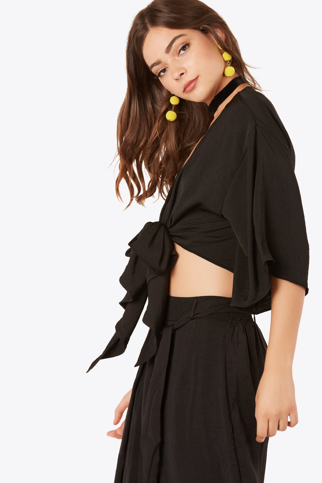 Flowy oversized top with open front design. Front tie closure with straight hem finish.