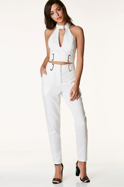 Chic high rise slacks with gold hardware and belted design at waist. Front zip and hooks for closure with tapered fit.