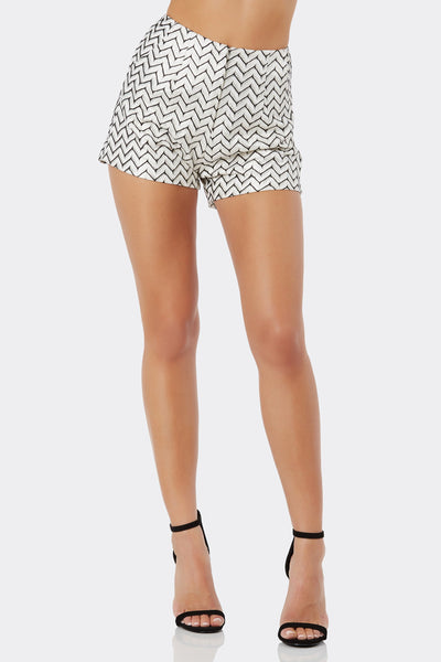 Chic high rise shorts with chvron pattern throughout. Fully lined with side pockets and front zip closure.
