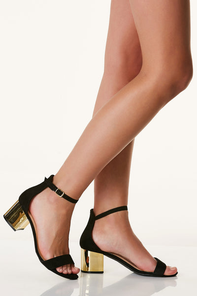 Flirty ankle strap heels with open toe finish. Soft suede exterior with contrast gold block heels.
