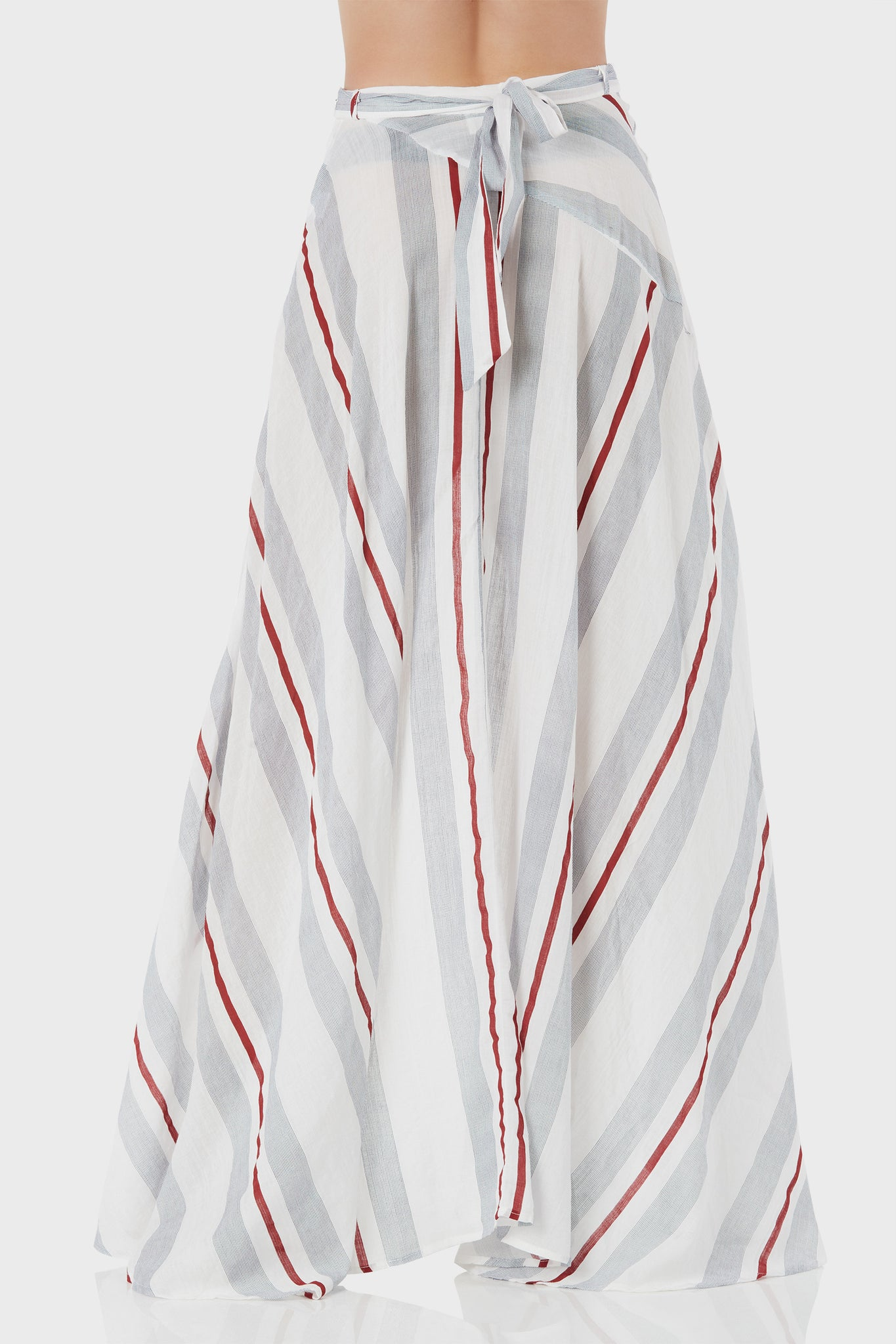 Flowy high rise skirt with wrap front design. Bold stripe print throughout with hi-low hem finish.